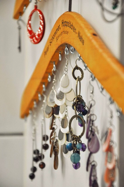 On a Hanger  Hangers are no longer just for clothes.  Get the tutorial at Household 6 Diva.  http://household6diva.com/2011/01/jewelryorganizationwoodenhangersrepurpo.html