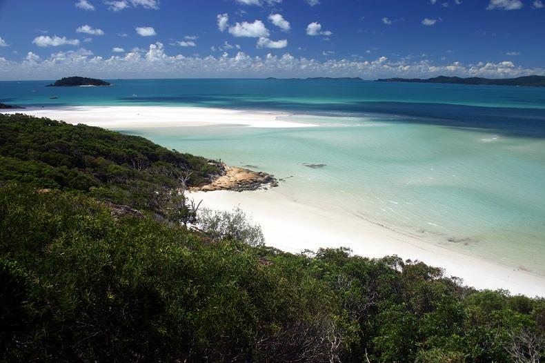 Whitehaven Beach Whitehaven Beach, which is located in Whitsunday Island, Australia. The sands on this beach are radiant white and consist of silica. This allows people to walk barefoot even on hot sunny days without feeling like their feet are getting really hot.