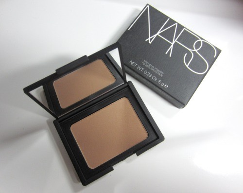 Use a matte dark powder or bronzer and contour the hollows of your face. It gives them more shadow to make u look slimmer.