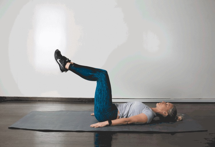 1. Heel Tap  Lie faceup, hands under your butt, knees bent, feet lifted into table top position. Slowly lower your flexed feet forward until your heels barely touch the ground. Squeeze your abdominals to help raise your feet back up to table top.