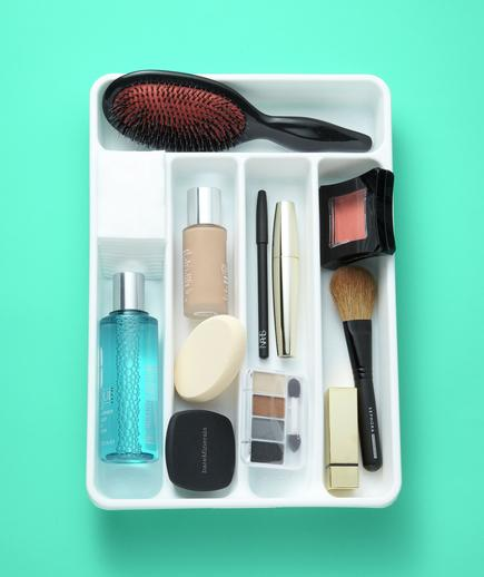 Beauty products scattered in your bathroom? Use a utensil tray in your bathroom drawer to keep small items like tweezers, nail clippers, and makeup brushes organized.