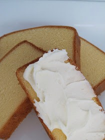 Slice the pound cake into thin layers and frost one side with desired frosting and sandwich them together.