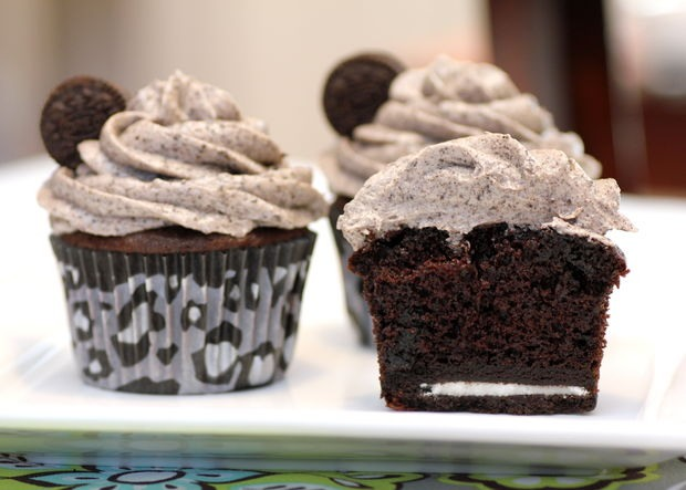 Ingredients: 1 package chocolate cake mix (mix according to directions on box) 1 package Oreo Cookies, regular size 1 package Mini Oreo Cookies, for decoration (optional) 8 ounces cream cheese, room temperature 1/2 cup butter (1 stick), room temperature 3 3/4 cups powdered sugar 1 teaspoon vanilla
