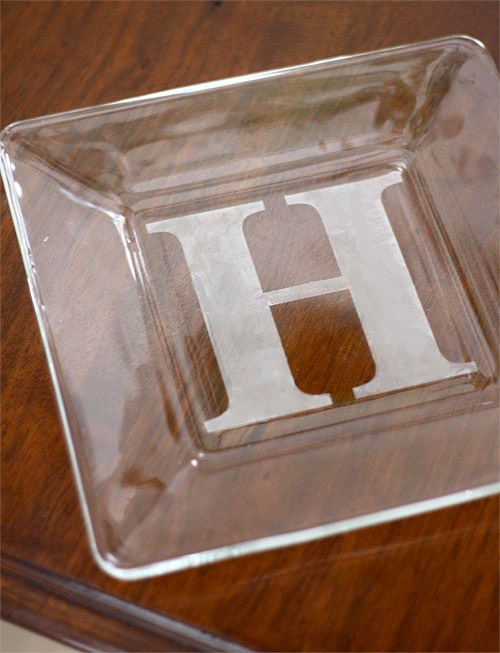 13. DIY Personalized Casserole Dish Customize a casserole dish, wine glass, or anything else glass with a personalized monogram. If you have a computer and a printer, you can just find the font you like and print it out in the size you need for the stencil.