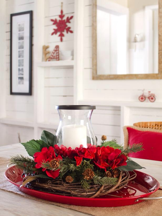 15-Minute Centerpiece Putting together a beautiful holiday centerpiece doesn't have to be difficult or break the bank. This one is made up of a few elements you might even have around the house, like a grapevine wreath form and a glass candleholder.