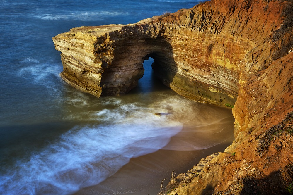 """The beautiful """"Sunset Cliffs"""" in San Diego California is a fantastic, free place to visit offering gorgeous views of naturally formed cliff variations and the ocean."""