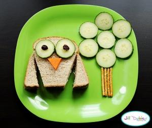 Take that plain sandwich and turn it into an Owl-Tree scenery. Cut the sides of the crust as shown for wings, add a cheese nose, some raisins for pupiles, and cucumbers for the eyes are tree leaves. And of course pretzels for the trunk, the kids will love it!