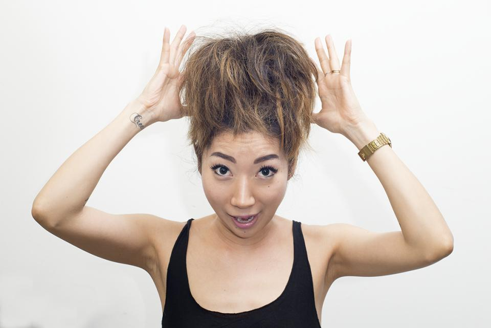 The first step is to put your hair into a ponytail and grab a handy dandy comb and comb the hair backwards. This will give your hair a fuller effect. After you do this you can either put a scrunchie around the bun or as I prefer pinning some bobby pins in.