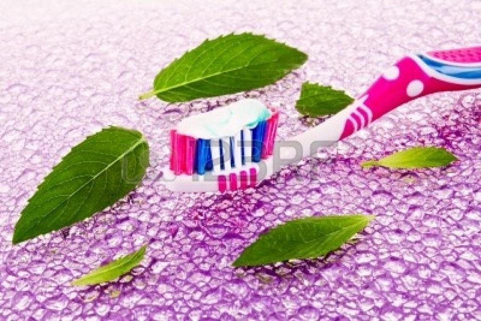 Keep a toothbrush in your purse and when you're at the bar, ask for a mint leaf. Freshen your breath without having to carry tooth paste! Easy and free!