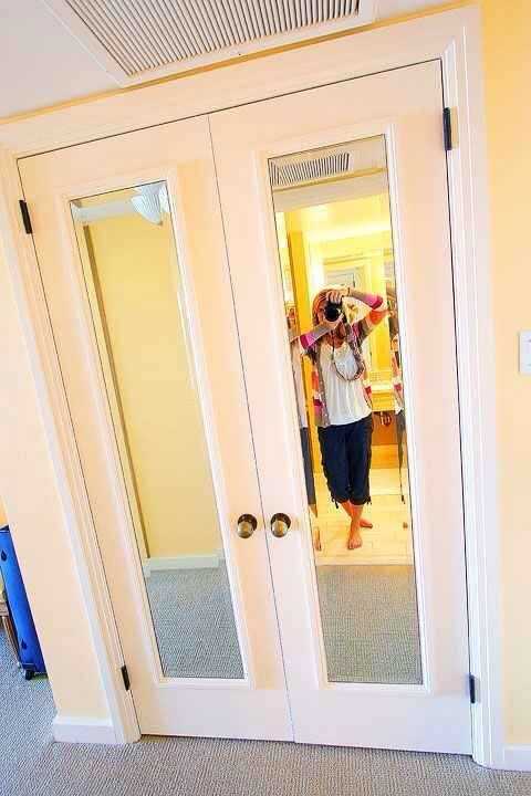 2. Add cheap framed mirrors to closet doors, painted to match.