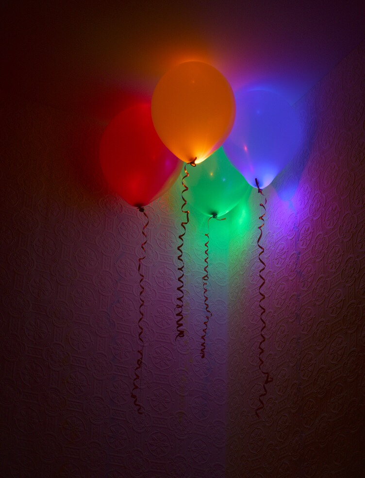 Glow in the dark balloons: you would sort of do the same thing like the water balloons but don't use water, put the liquid in then blow it up tie it and put it where you want. These look really cool in late night party's