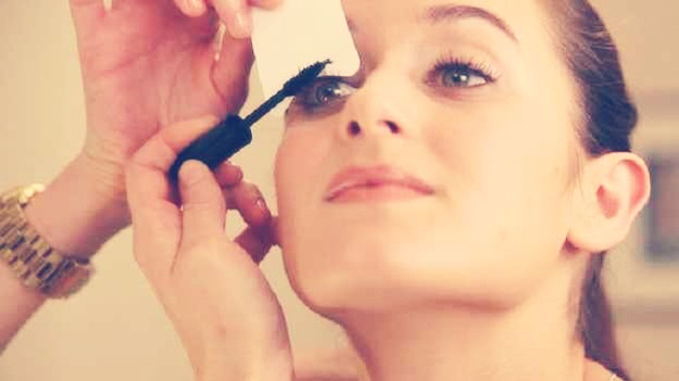 Use a business card or a note card to get the best mascara line.