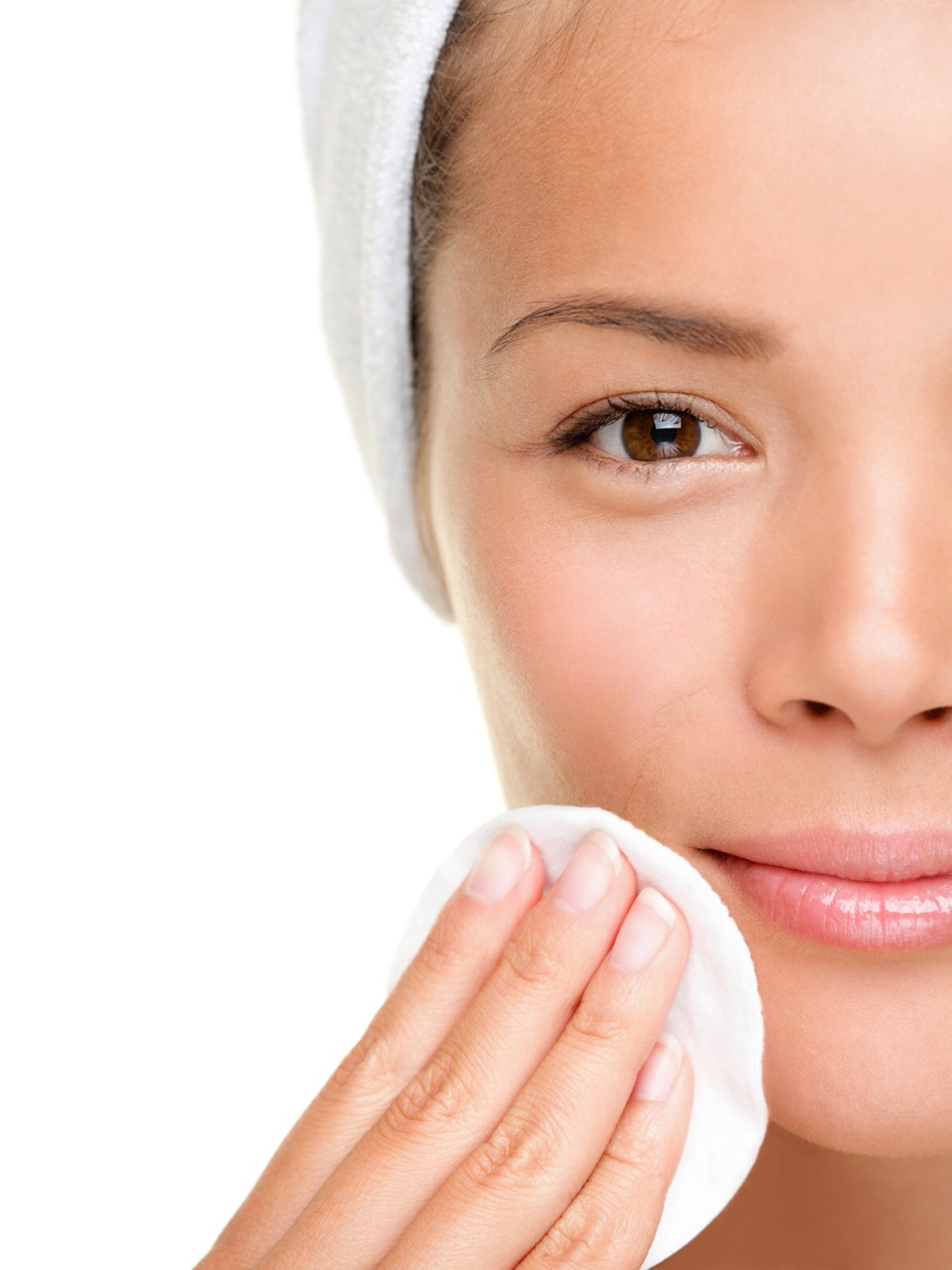 Start by applying baby oil on the cotton balls and gently rubbing it on your face.