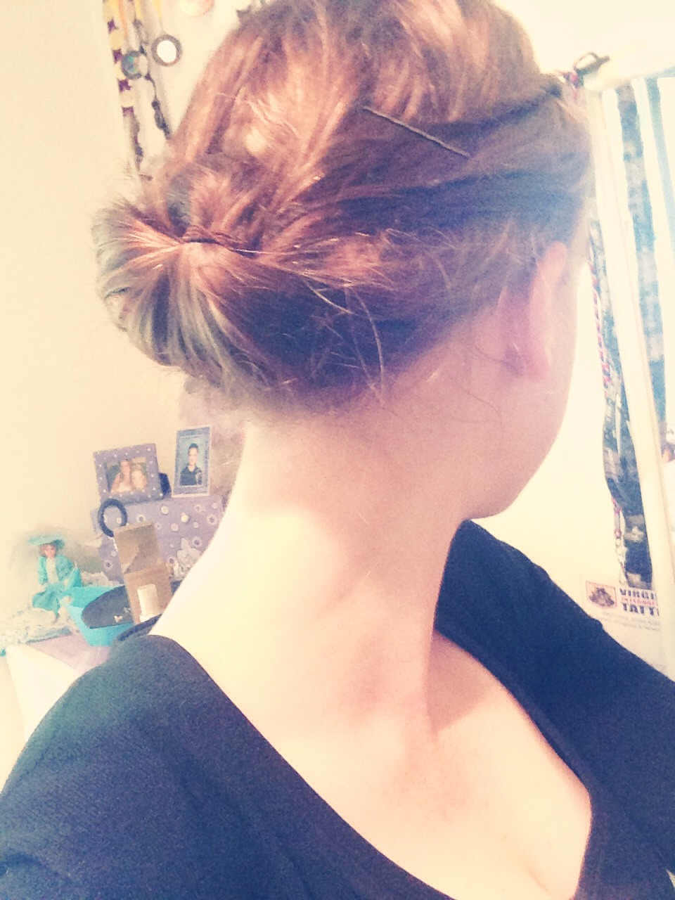 Tuck hair between first half up pony tail