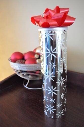 Wrap an empty Pringles can with paper and add a bow.  Great way to give cookies as gifts.