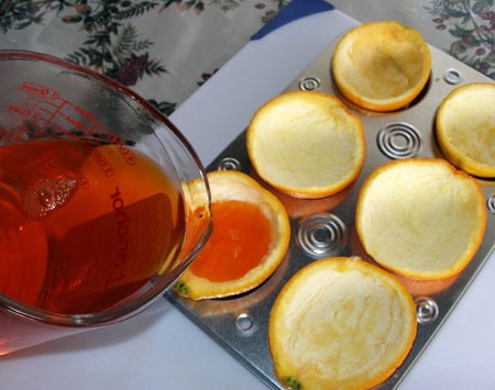 Put the Orange peels in a muffin pan and fill them with jello
