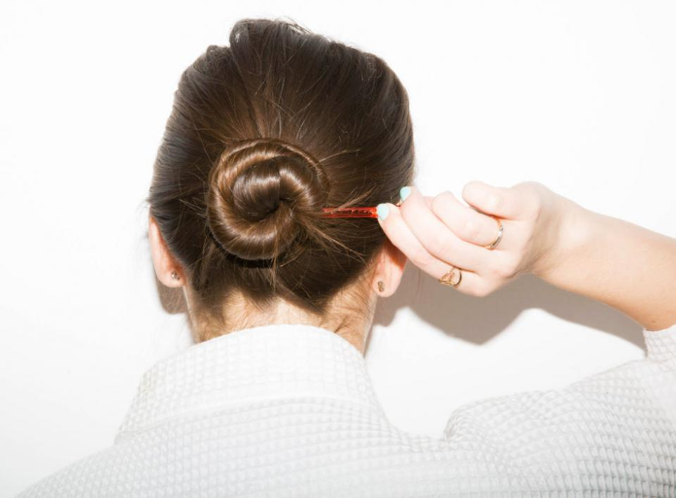 15. If you've washed your hair but don't have the energy to blow it dry, loosely twist your hair into a low bun, secure with a clip, and go about your life. When it's dry, untwist the hair and separate the tendrils with your fingers for effortless waves.