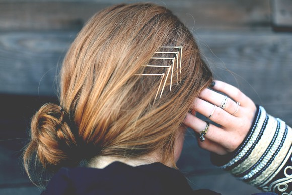 take 2 bobby pins and put them together to make a upside down v