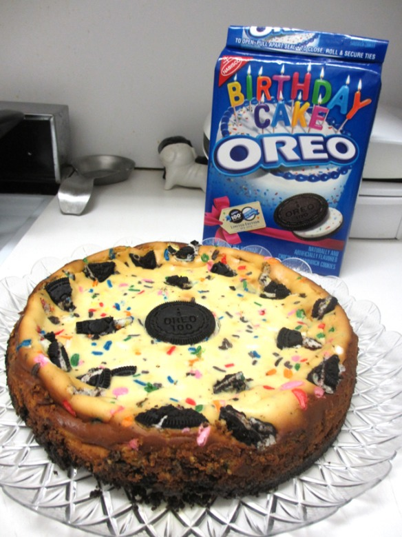 3. Pour the filling onto the crust. Sprinkle 1/2 teaspoon sprinkles and remaining chopped cookies on top.  4. Bake for 35 to 40 minutes or until center is almost set. Cool. (NOTE: If using a springform pan, run small knife around rim of pan to loosen cake and remove the rim.) Refrigerate for 3 hours