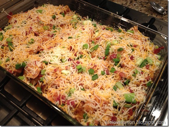 4.In a bowl mix together the cheese, bacon & green onion and top the raw chicken with the cheese mix. Return the casserole to the oven and bake for 15 minutes or until the chicken is cooked through and the topping is bubbly delicious.