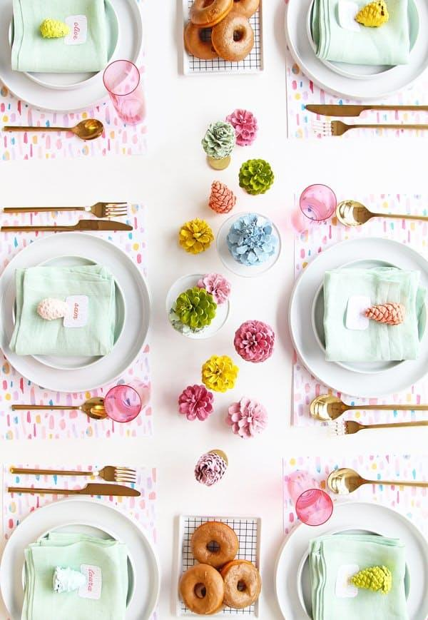For a more modern spin on nature, gather up some pinecones and spray paint them in your favorite fresh holiday shades, like in this cheery tablescape fromA Subtle Reverly.