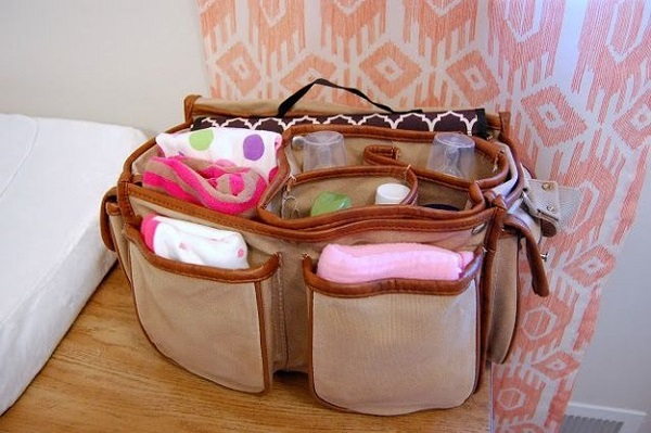 A camera bag makes the perfect diaper bag thanks to it's many pockets and compartments.