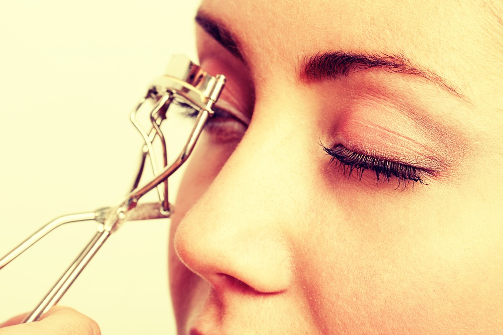 Then curl your eyelashes starting at the root and hold for 10 seconds