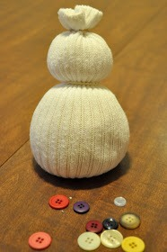 Rubber band the top of the sock closed and put another rubber band 3/4 of the way to the top for the head of your snowman.