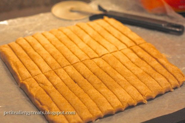4. Carefully peel cookie strips off of paper and place on cookie sheet lined with parchment paper.  They won't spread, so they can be very close. 5. Bake at 375 for 12-14 mins or until slightly golden brown. 6. Take out and allow to cool.