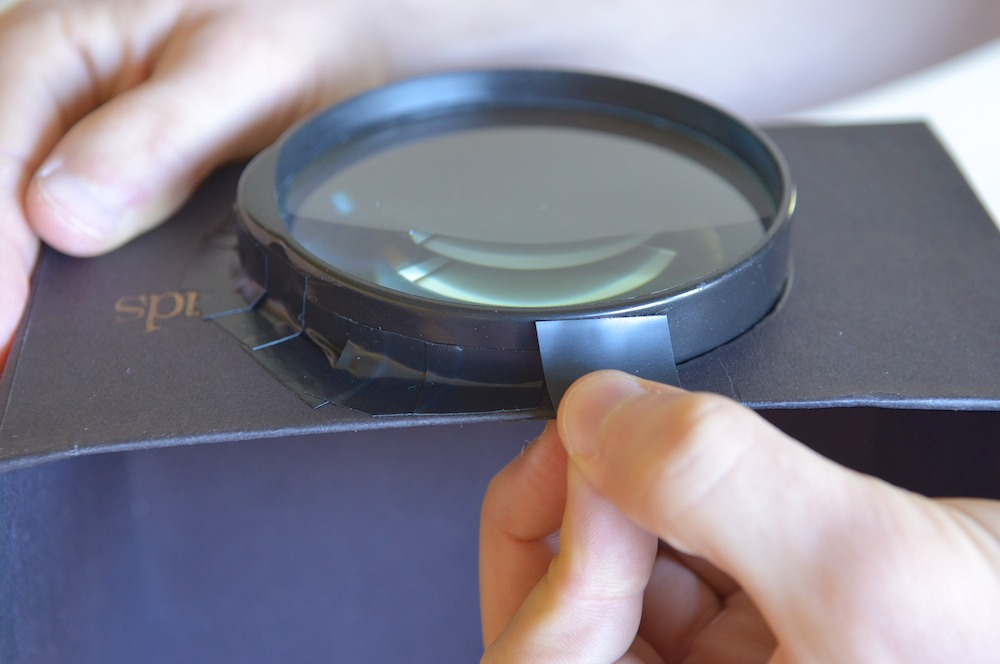 Tape the magnifying glass, making sure no light leaks out.