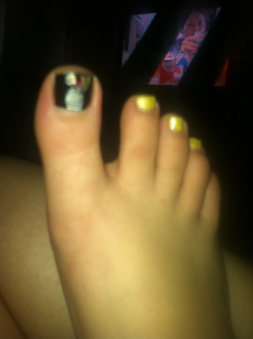 Big toe- black base, white rectangle, orange or yellow oval, and a black line for a wick.  The rest of the toes will be yellow for sunshine.