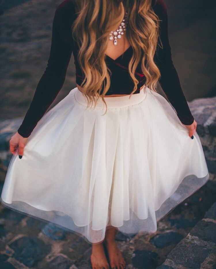 Items: 1.) Long Black V-Neck Crop Top 2.) Puffy/Flowy White Skirt Knee Length  3.) White Bubble Necklace
