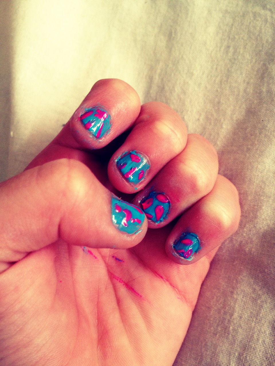 Here is the way to make these striped pink and blue nail design