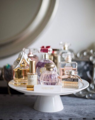 5. Display pretty fragrances on top of a cake stand.