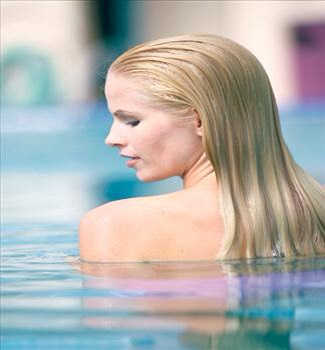 Drying chlorine or salt water can do a number on your hair, especially if you've dabbled in color or chemical treatments. But have NO fear, you won't be banished to spend the entire summer indoors, as a few experts shared their tips so you can get wet without worry this summer.