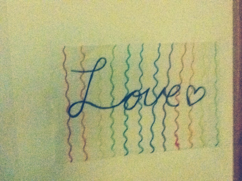 "If your feeling crafty you can make your own decorations! I made this using thing see through paper ( DON'T USE WAX PAPER IT IS RESISTANT TO ALMOST EVERYTHING AND THE MARKER WILL JUST RUB OFF)! I did a rainbow background and then put the word ""Love"" in cursive.(:"