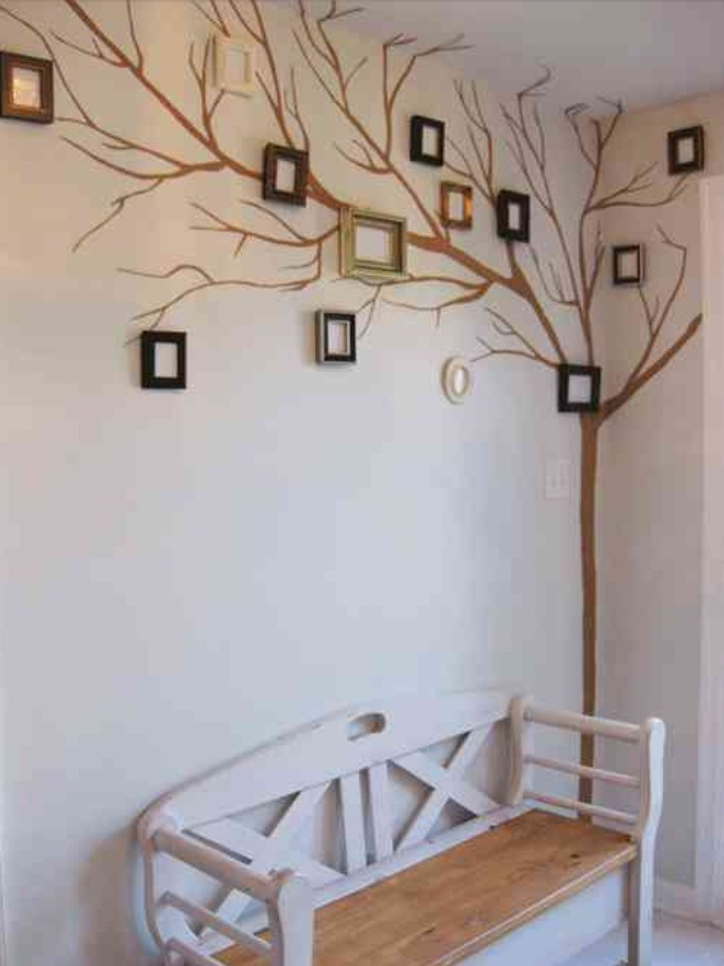 Pain tree limbs and place small frames with family members on the limbs. So creative and special.