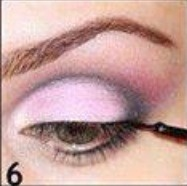 Apply liquid eyeliner and try to stay as close to the lashes as possible.