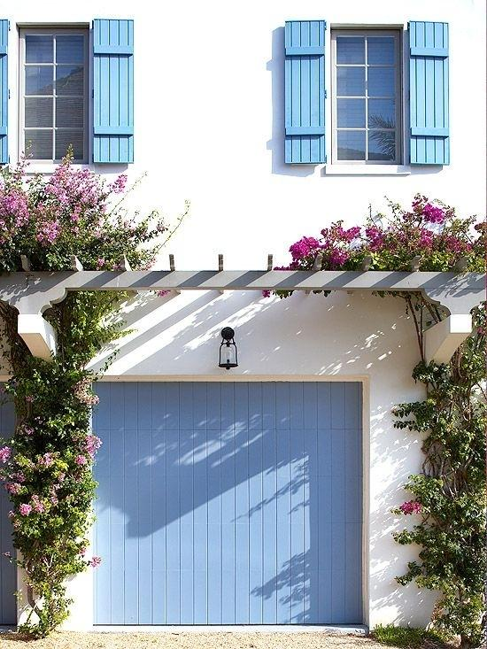 Update your garage door with a fresh coat of paint.  Bonus points if it matches the shutters.