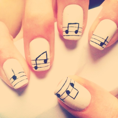 Use some white nail polish on the nail then you can do the music notes with some black nail polish on a nail art brush.