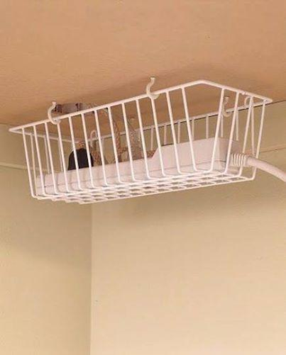 Keep your power strips off the floor and out of view by hanging a wire basket under your desk. This is also a great solution for short cords that don't reach the top of your desk without an extension, like a phone charger.