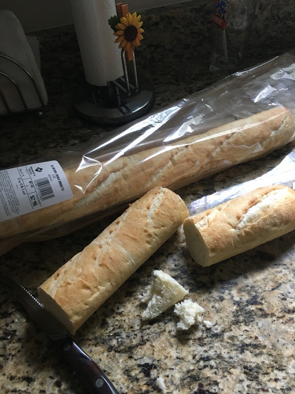 "Meanwhile, cut the baguettes in about 4-5"" pieces. You can either slice it in the middle or try to take out the inside soft part from the ends"
