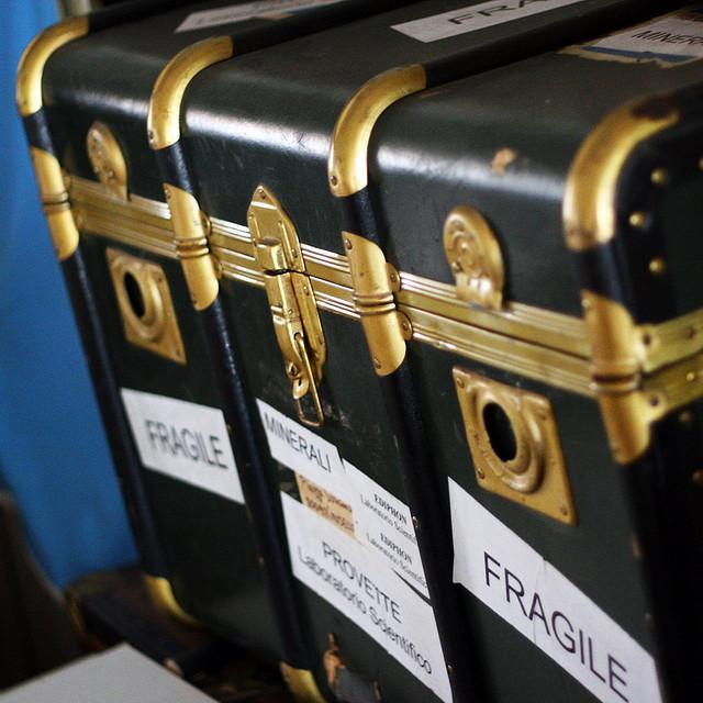 """Get a """"Fragile"""" tag for your suitcase—not only will it prevent your bag from being thrown around, but it will also put it at the top, which means it will be one of the first bags off the plane."""
