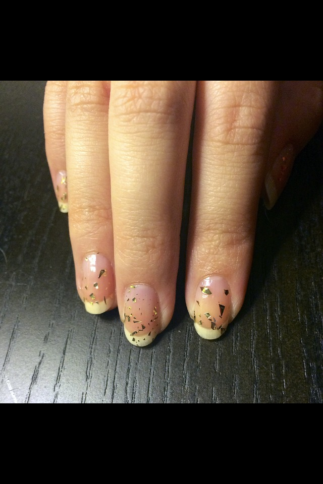 Step One After applying your base coat, paint one layer of the gold foil polish all over your nails. This allows for a hint of your natural nail to peek through.