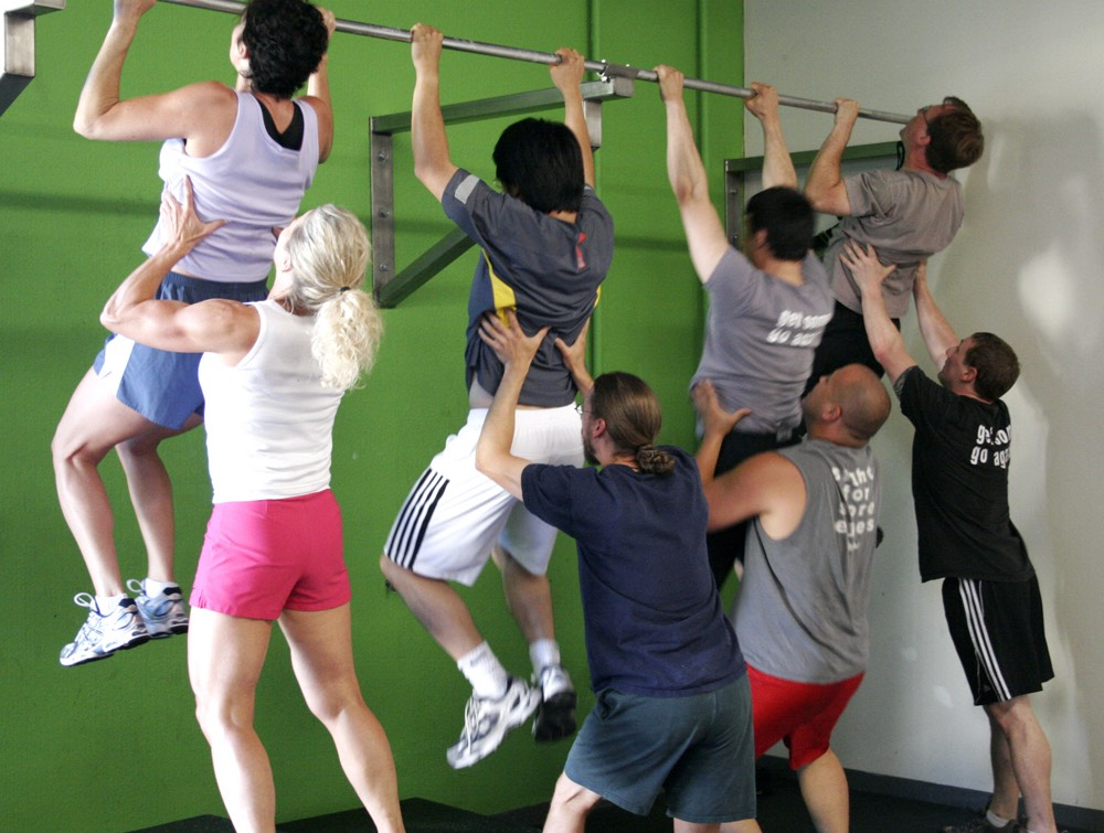 Assisted pull ups with a partner- (have a friend hold your feet behind you and help you complete each rep).  Have your friend use the least amount of help possible to get you through your workouts.