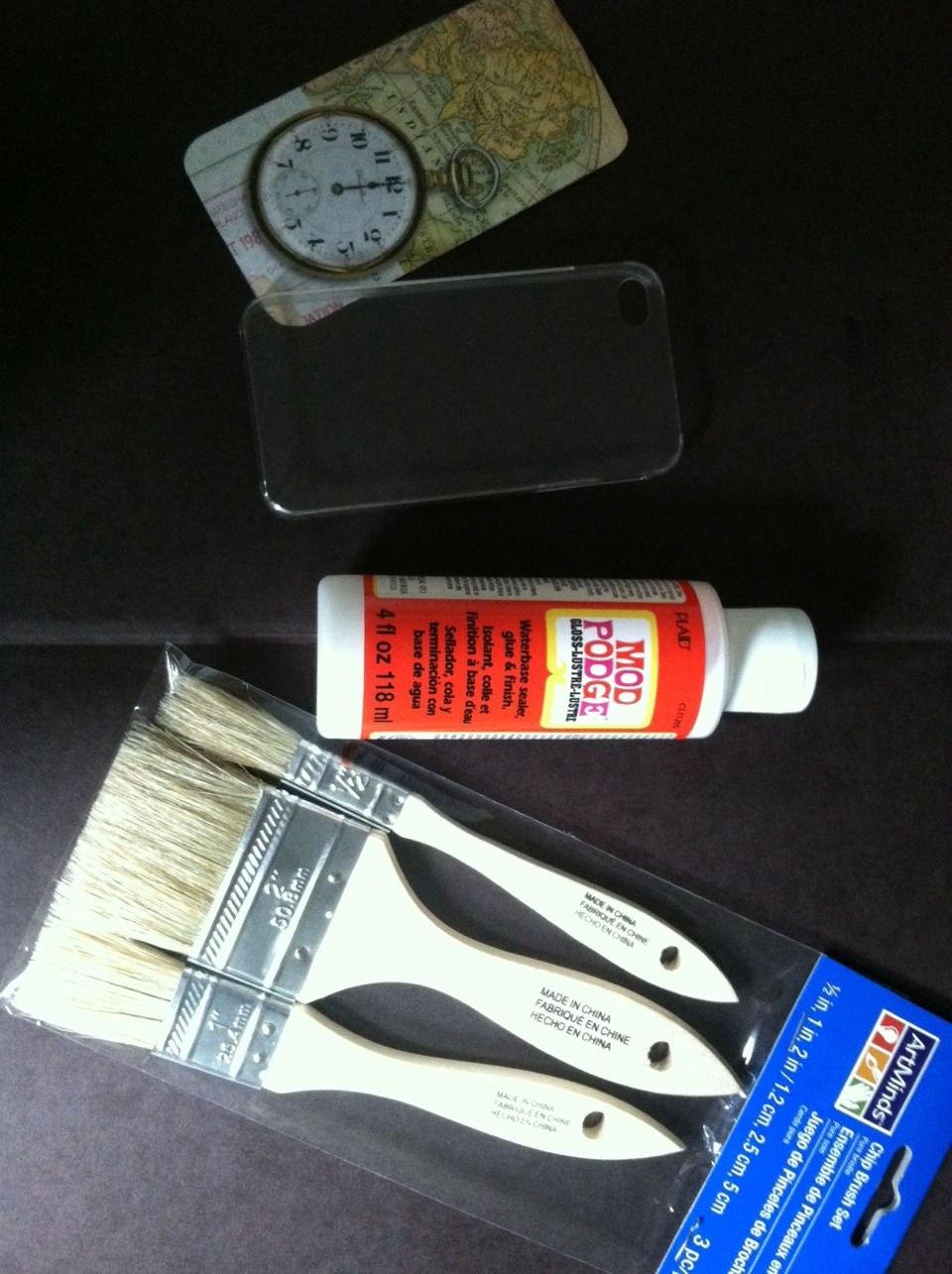 Next you will take your Mod Podge and brush and place your paper on your phone case, then apply the Mod Podge then take your brush, & spread it every where!!! Let it sit for at least a DAY!!!