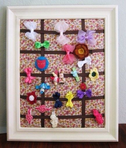 Frames for Hair Clips  Update an old picture frame with paint, fabric, and ribbon and use it turn hair clips into wall art.