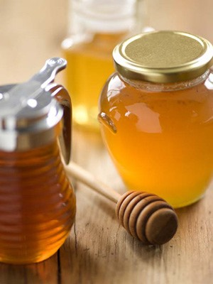 When five minutes are up, wash off the paste and then apply a small dab of honey to the blemishes. Wash the honey off after 10 minutes, and your skin will be clearer.