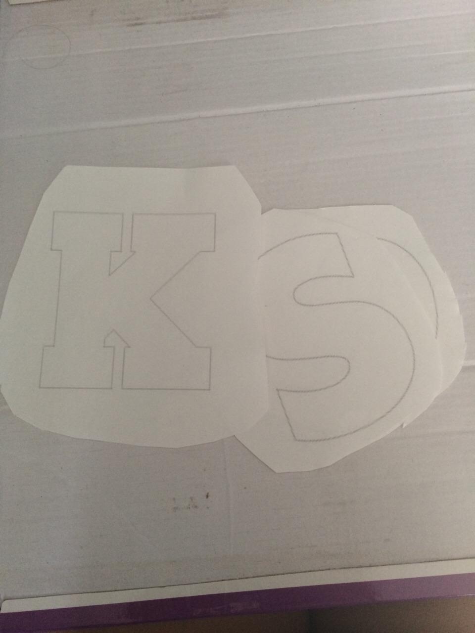 cardboard + letter stencils (I got mine from google images)
