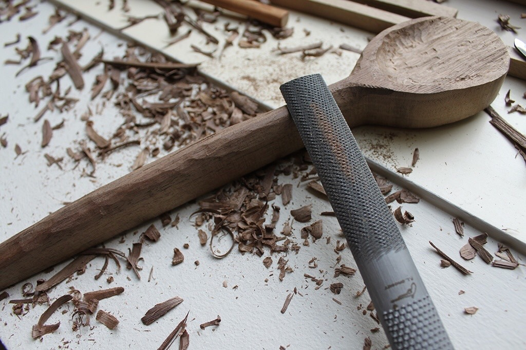 STEP 3: Now you can begin to carve the handle to make your desired shape. Work from the spoon bowl side to the end of the handle. Take away little strips and avoid trying to dig too deep. This will give you more control over the look of the handle.